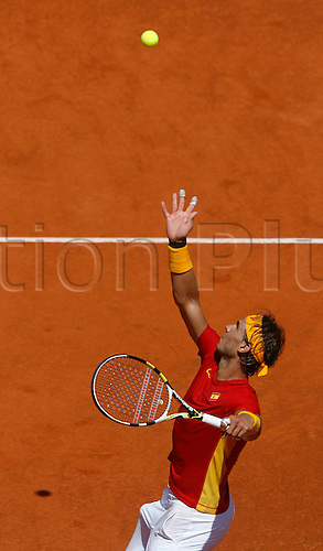 16.09.2011. Cordoba, Spain. Davis Cup tennis match. Spain versus France.  Rafel Nadal serves in his singles match