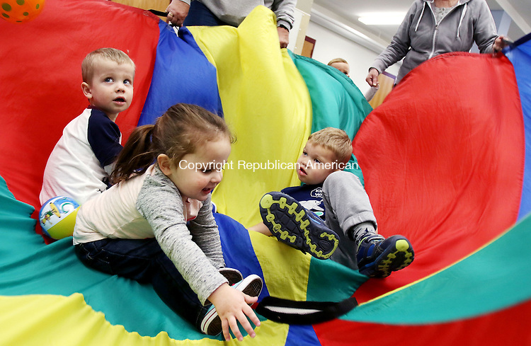MIDDLEBURY CT. 08 April 2016-040816SV03-From left, Silas Dube-Soucy, 2, of Southbury Bryce Erwin, 2, of Middlebury, and Nicholas Nagrabski, 3, of Middlebury get spun in a multi colored parachute during the Jump Bunch group run by Park and Recreation in Middlebury Friday.<br /> Steven Valenti Republican-American