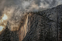 A winter storm breaks over Yosemite's El Capitan & Horsetail Falls.
