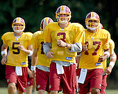 Ashburn, VA - August 2, 2007 -- Quarterbacks run towards their position meeting on a hot afternoon during the 2007 Washington Redskins training camp in Ashburn, Virginia.  From left to right: Casey Bramlet (5), Todd Collins (15), partially hidden, Jordan Palmer (3), Jason Campbell (17), and Mark Brunell (8), hidden behind Campbell..Credit: Ron Sachs / CNP