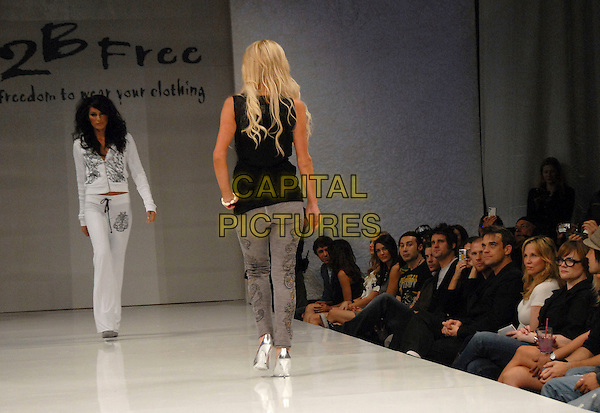 PARIS HILTON.attends The 2 B Free Fashion Show held at Boulevard3  in Hollywood, LA, California, USA, March 19 2007..full length catwalk runway modelling black top grey leggings back behind rear.CAP/DVS.©Debbie VanStory/Capital Pictures