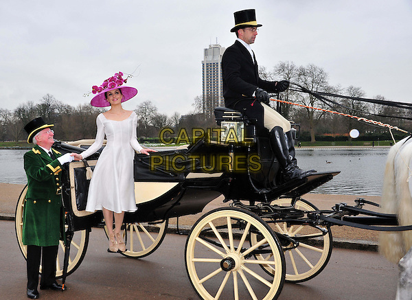 Victoria Pendleton, wearing Emilia Wickstead and Philip Treacy.At a photocall to launch the Royal Ascot 2012 campaign 'The Colour and the Glory' in Hyde Park, London, England, UK, 24th January 2013..full length getting out of beige t-bar shoes  pink hat flowers orchids fuchsia white sitting in carriage smiling .CAP/BF.©Bob Fidgeon/Capital Pictures.