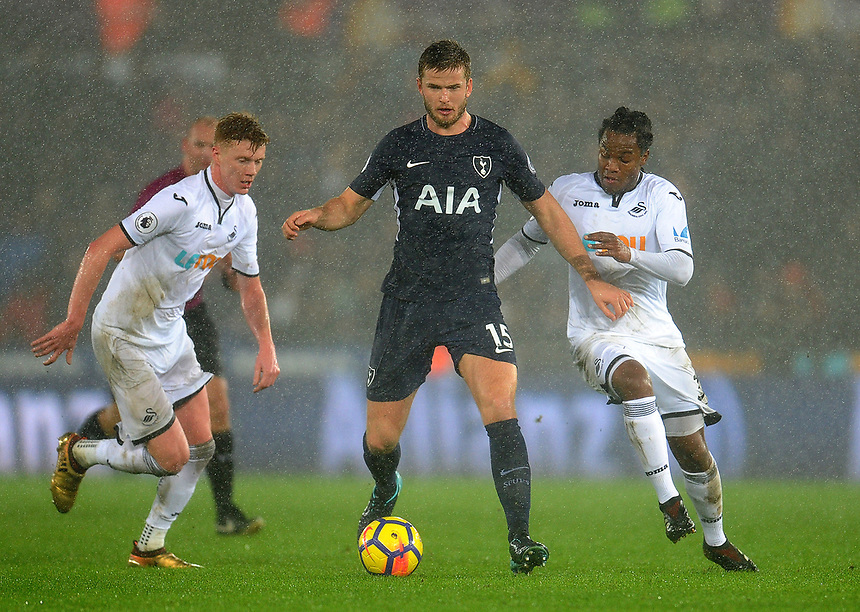 Tottenham Hotspur's Eric Dier vies for possession with Swansea City's Renato Sanches<br /> <br /> Photographer Ashley Crowden/CameraSport<br /> <br /> The Premier League - Swansea City v Tottenham Hotspur - Tuesday 2nd January 2018 - Liberty Stadium - Swansea<br /> <br /> World Copyright &copy; 2018 CameraSport. All rights reserved. 43 Linden Ave. Countesthorpe. Leicester. England. LE8 5PG - Tel: +44 (0) 116 277 4147 - admin@camerasport.com - www.camerasport.com