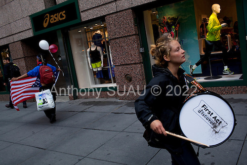 New York, New York<br /> May 1, 2012<br /> <br /> May Day in Manhattan as demonstrators come out in strength to mark the day and support the &quot;Occupy&quot; movement.<br /> <br /> Protesters march near Bryant Park.