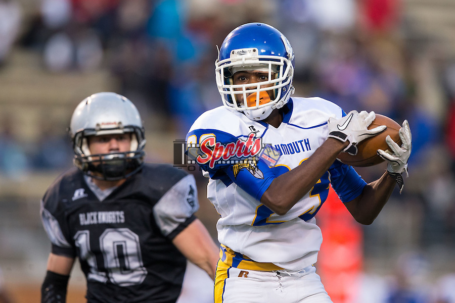 Taqan White (23) of the Plymouth Vikings catches a pass in front of Lane Millsaps (10) of the Robbinsville Black Knights during first half action in the NCHSAA 1A State Championship at BB&T Field on December 12, 2015 in Winston-Salem, North Carolina.  The Vikings defeated the Black Knights 28-20.  (Brian Westerholt/Sports On Film)