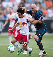 Conor Casey (6) of the Philadelphia Union tries to get around Kosuke Kimura (27) of the New York Red Bulls during a Major League Soccer game at PPL Park in Chester, PA.  Philadelphia defeated New York, 3-0.