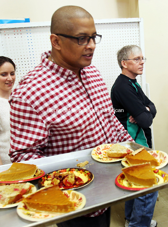 WATERBURY CT. 24 November 2016-112416SV07-Lennaire Strother of Seymour serves pie during the Thanksgiving Day dinner at the First Congregational Church in Waterbury Thursday. The dinner sponsored by the Greater Waterbury Interfaith Ministry's cooked 325 pounds of Turkey and served approximately 300 guests. <br /> Steven Valenti Republican-American