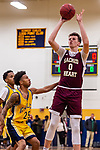 WATERBURY, CT. 09 December 2018-120918 - Sacred Heart center Connor Tierney #0 shoots over Kennedy guard Matt Torres #25 during the annual Waterbury Boys Basketball Jamboree at Kennedy High School in Waterbury on Sunday. Bill Shettle Republican-American