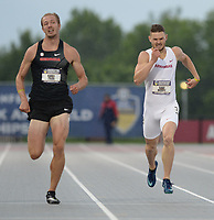 NWA Democrat-Gazette/ANDY SHUPE<br /> Arkansas' Gabe Moore (right) trails Georgia's Karel Tilga Thursday, May 9, 2019, in the 400 meters portion of the decathlon during the SEC Outdoor Track and Field Championships at John McDonnell Field in Fayetteville. Visit nwadg.com/photos to see more photographs from the meet.