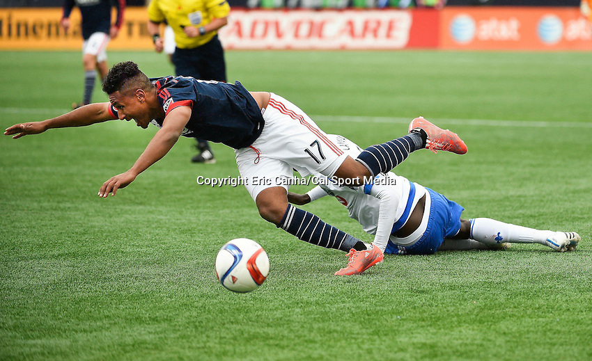 March 21, 2015 - Foxborough, Massachusetts, U.S. - New England Revolution forward Juan Agudelo (17) falls to the ground after having his jersey pulled by Montreal Impact defender Hassoun Camara (6) during the MLS game between the Montreal Impact and the New England Revolution held at Gillette Stadium in Foxborough Massachusetts. The play resulted in Camara's second yellow card of the day and ejection from the game. The Revolution and the Impact ended the game tied 0-0. Eric Canha/CSM