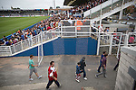 Supporters of Middlesbrough making their way out of the Victoria Ground, Hartlepool, at the conclusion of a pre-season friendly between their team and Hartlepool United. Hartlepool were relegated to League Two at the end of the 2012-13 season whilst their Teesside neighbours remained two divisions above them in the Championship. The game ended in a no-score draw, the home team's goalkeeper Scott Flinders saving a second-half penalty from Boro's Lucas Jutkiewicz, watched by a crowd of 2307.