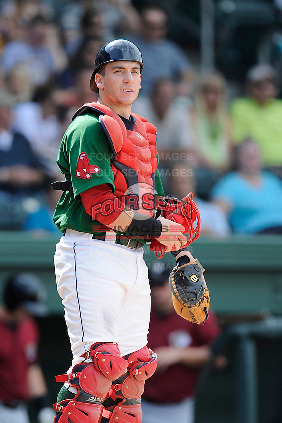 Catcher Jordan Procyshen (29) of the Greenville Drive in a game against the Savannah Sand Gnats on Sunday, August 24, 2014, at Fluor Field at the West End in Greenville, South Carolina. Greenville won, 8-5. (Tom Priddy/Four Seam Images)