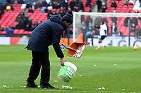 Ground staff sweep the snow falling off the Wembley arch off the pitch before Tottenham Hotspur vs Newcastle United, Premier League Football at Wembley Stadium on 2nd February 2019