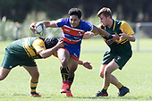 Katetistoti Nginingini tries to break past Dillon Puddick and Ian West-Stevens.  Counties Manukau Premier Counties Power Game of the Week Club Rugby Round 4 game between Pukekohe and Ardmore Marist, played at Colin Lawrie Fields Pukekohe on Friday March 30th 2018.<br /> Ardmore Marist won the game 27 - 21 after leading 13 - 11 at halftime.<br /> Pukekohe Mitre 10 Mega 21 -Trent White, Samu Pailegutu tries, Sione Fifita conversion, Sione Fifita 2, Vilitati Sabani penalties. Ardmore Marist South Auckland Motors 27 - Katetistoti Nginingini, Karl Ropati, Alefosio Tapili tries, Latiume Fosita 3 conversions, Latiume Fosita 2 penalties. <br /> Photo by Richard Spranger.