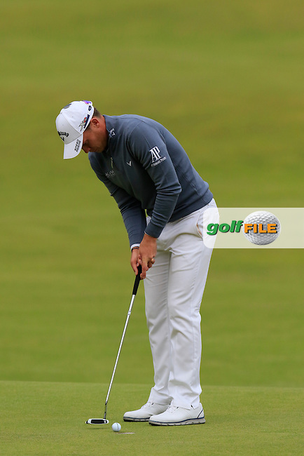 Danny WILLETT (ENG) taps in on the 18th green during Sunday's Round 3 of the 144th Open Championship, St Andrews Old Course, St Andrews, Fife, Scotland. 19/07/2015.<br /> Picture Eoin Clarke, www.golffile.ie