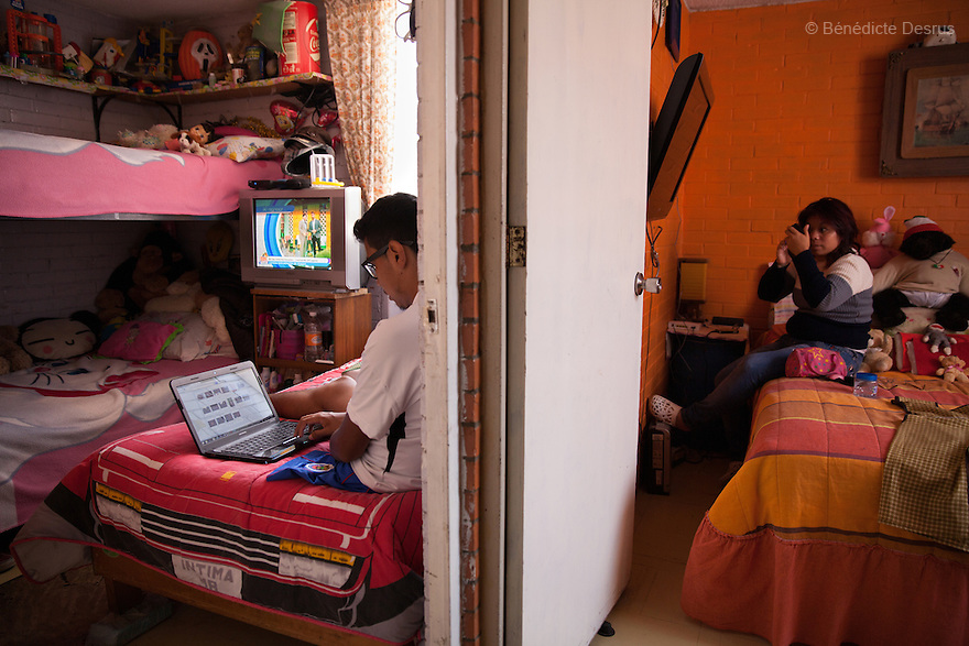 "Baruch in his bedroom at his home in the Iztapalapa area of Mexico City, Mexico on July 8, 2014. Guerreros Aztecas (""Aztec Warriors"") is Mexico City's first amputee football team. Founded in July 2013 by five volunteers, they now have 23 players, seven of them have made the national team's shortlist to represent Mexico at this year's Amputee Soccer World Cup in Sinaloa this December. The team trains twice a week for weekend games with other teams. No prostheses are used, so field players missing a lower extremity can only play using crutches. Those missing an upper extremity play as goalkeepers. The teams play six per side with unlimited substitutions. Each half lasts 25 minutes. The causes of the amputations range from accidents to medical interventions – none of which have stopped the Guerreros Aztecas from continuing to play. The players' age, backgrounds and professions cover the full sweep of Mexican society, and they are united by the will to keep their heads held high in a country where discrimination against the disabled remains widespread. (Photo by Bénédicte Desrus)"