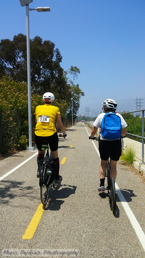 Holland, on his Yedoo kick scooter, and Michelle, on her Terry Burlington city bike, relax and chat as they ride down the Los Angeles River Greenway Trail during the 2017 (17th annual) Los Angeles River Ride.