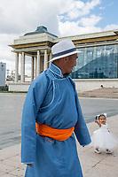 Mongolia, Ulaanbaatar. Sukhbaatar Square, man and little girl.