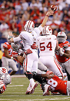 Ohio State Buckeyes defensive lineman Joey Bosa (97) and defensive lineman Steve Miller (88) force Wisconsin Badgers quarterback Joel Stave (2) to throw an incomplete pass during the third quarter of the Big Ten Championship game at Lucas Oil Stadium in Indianapolis on Dec. 6, 2014. (Adam Cairns / The Columbus Dispatch)