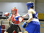 Luke Maguire (in red) from Drogheda boxing Club and Jason Irwin from Castleblaney Boxing Club in action in the Louth Meath Boxing Championships held in Holy Family Boxing Club Ballsgrove.  Photo:Colin Bell/pressphotos.ie