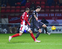 Lincoln City's Jason Shackell clears under pressure from  Crewe Alexandra's Jordan Bowery<br /> <br /> Photographer Andrew Vaughan/CameraSport<br /> <br /> The EFL Sky Bet League Two - Crewe Alexandra v Lincoln City - Wednesday 26th December 2018 - Alexandra Stadium - Crewe<br /> <br /> World Copyright &copy; 2018 CameraSport. All rights reserved. 43 Linden Ave. Countesthorpe. Leicester. England. LE8 5PG - Tel: +44 (0) 116 277 4147 - admin@camerasport.com - www.camerasport.com