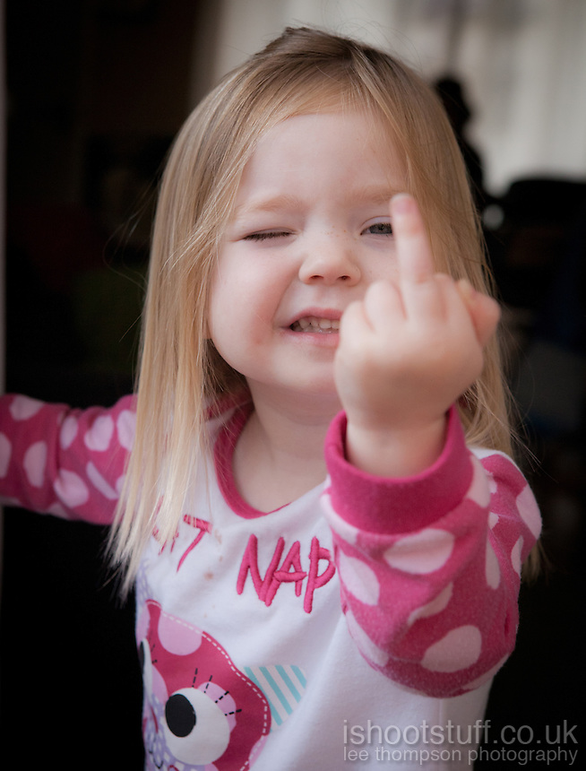 Young girl showing the middle finger.