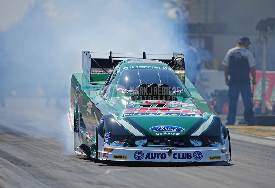 Jul. 1, 2012; Joliet, IL, USA: NHRA funny car driver John Force during the Route 66 Nationals at Route 66 Raceway. Mandatory Credit: Mark J. Rebilas-