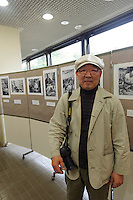 "Photographer Masatsugu Yokoyama at and exhibition of his historic prints of Yanaka, Yanaka, Tokyo, Japan, April 19, 2012. Yanaka is part of Tokyo's ""shitamachi"" historic working class wards. Recently it has become popular with Japanese and foreign tourists for its many temples, shops, restaurants and relaxed atmosphere."