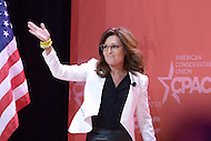 National Harbor, MD - February 26, 2015: Former Alaska Governor Sarah Palin enters the stage before she speaks to attendees of the Conservative Political Action Conference (CPAC) at National Harbor, MD, February 26, 2015.  (Photo by Don Baxter/Media Images International)