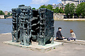 Paris, France. 09.05.2015.A couple enjoys the warm Spring sunshine, by the Seine. Temperatures reached 17C in the French Capital. Photograph © Jane Hobson.