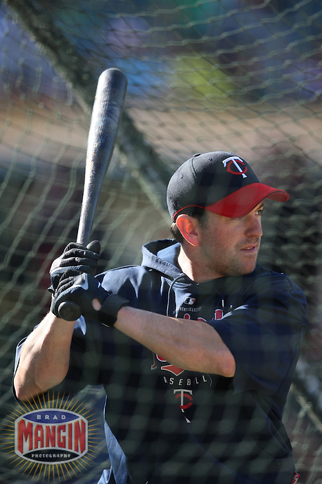OAKLAND, CA - AUGUST 30:  Nick Punto of the Minnesota Twins takes batting practice before the game against the Oakland Athletics at the McAfee Coliseum in Oakland, California on August 30, 2008.  The Athletics defeated the Twins 3-2.  Photo by Brad Mangin