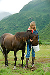 Malisa grains a horse at the Pasagshak Ranch at Kodiak Island, Southwest Alaska