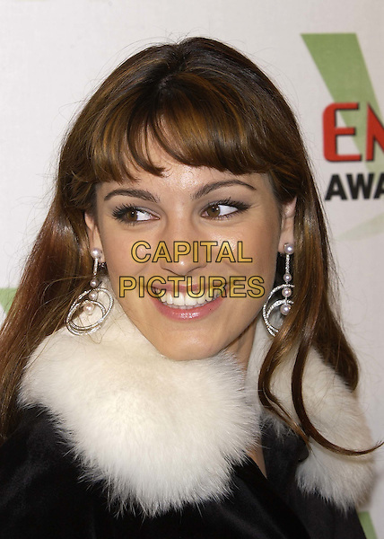 KELLY BROOK.Empire Awards 2004.Dorchester Hotel, Park Lane.4 February 2004.portrait, headshot, fringe, hair, big drop dangly earrings, fur collar.sales@capitalpictures.com.www.capitalpictures.com.©Capital Pictures