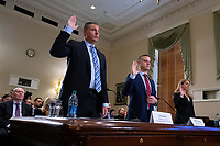 From left to right: Tom Burt, President and CEO of Election Systems & Software, John Poulos, President and CEO of Dominion Voting Systems, and Julie Mathis, President and CEO of Hart InterCivic, are sworn in before the United States Committee on House Administration on Capitol Hill in Washington D.C., U.S., on Thursday, January 9, 2020.  Dominion Voting Systems, Hart InterCivic, and Election Systems and Software, the three main voting equipment producers in the United States, have faced criticism from lawmakers following Russian interference in the 2016 election.<br /> <br /> Credit: Stefani Reynolds / CNP/AdMedia