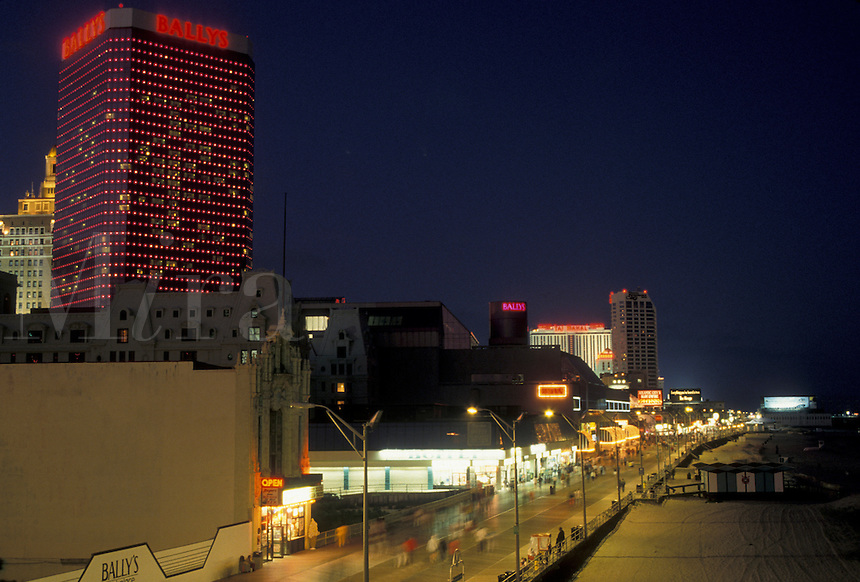 AJ4332, boardwalk, Atlantic City, New Jersey, Amusements, hotel casinos, stores, and concessions along the famous Boardwalk in Atlantic City illuminated at night in the state of New Jersey.