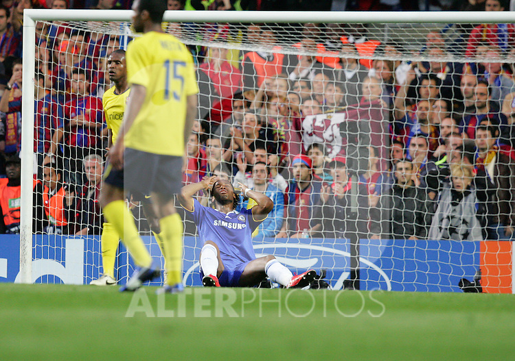 A dejected Didier Drogba holds his head in despair after missing out on a penalty claim during the first half of the UEFA Champions League Semi Final Second Leg match between Chelsea and Barcelona at Stamford Bridge on May 6, 2009 in London, England.