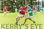 West Kerry Jimmy O'Grady in possession of the ball tackled by Killarney Legion Damien O'Sullivan during the County Senior Football Champhionship Round 2A match at Paddy Kennedy Memorial Park, Annascaul, on Sunday afternoon.