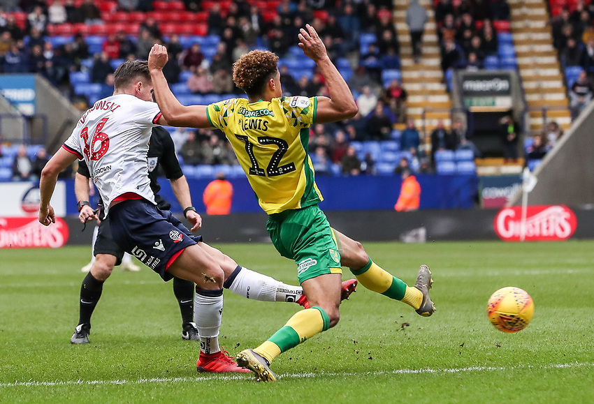 Bolton Wanderers' Pawel Olkowski shoots at goal under pressure from  Norwich City's Jamal Lewis  <br /> <br /> Photographer Andrew Kearns/CameraSport<br /> <br /> The EFL Sky Bet Championship - Bolton Wanderers v Norwich City - Saturday 16th February 2019 - University of Bolton Stadium - Bolton<br /> <br /> World Copyright © 2019 CameraSport. All rights reserved. 43 Linden Ave. Countesthorpe. Leicester. England. LE8 5PG - Tel: +44 (0) 116 277 4147 - admin@camerasport.com - www.camerasport.com