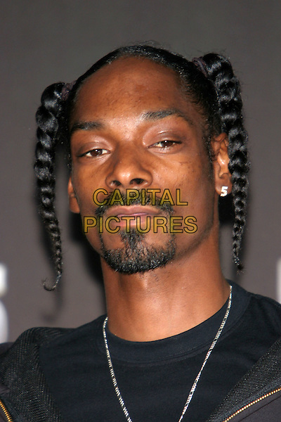 SNOOP DOGG. 25 Strong: The BET Silver 25th Anniversary Special - Press Room held at the Shrine Auditorium, Los Angeles, California..October 26th, 2005.Photo: Zach Lipp/AdMedia/Capital Pictures.Ref: ZL/ADM/CAP.headshot portrait beard facial hair braids plaits ponytails .www.capitalpictures.com.sales@capitalpictures.com.© Capital Pictures.