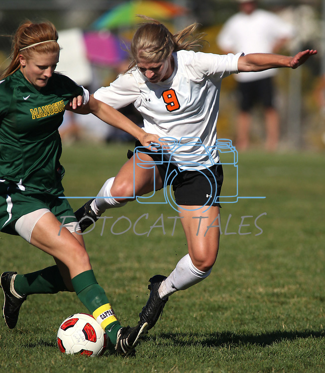 Katie Dry fights for the ball with Manogue's Camille Allen during a 4-1 Douglas victory on Tuesday, Sept. 20, 2011, in Gardnerville, Nev..Photo by Cathleen Allison
