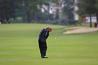Miguel Angel Jimenez (ESP) plays his 2nd shot on the 1st hole during a wet Saturday's Round 3 of the 2017 Omega European Masters held at Golf Club Crans-Sur-Sierre, Crans Montana, Switzerland. 9th September 2017.<br /> Picture: Eoin Clarke | Golffile<br /> <br /> <br /> All photos usage must carry mandatory copyright credit (&copy; Golffile | Eoin Clarke)