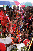 Lolgorian, Kenya. Siria Maasai; Eunoto ceremony; moran drinking the blood of the sacrificed bull.