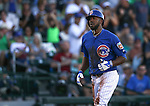 Chicago Cubs' Dexter Fowler scores on a throwing error in a spring training game against the Diamondbacks in Mesa, Ariz., on Thursday, March 17, 2016. The Cubs won 15-4.<br />Photo by Cathleen Allison