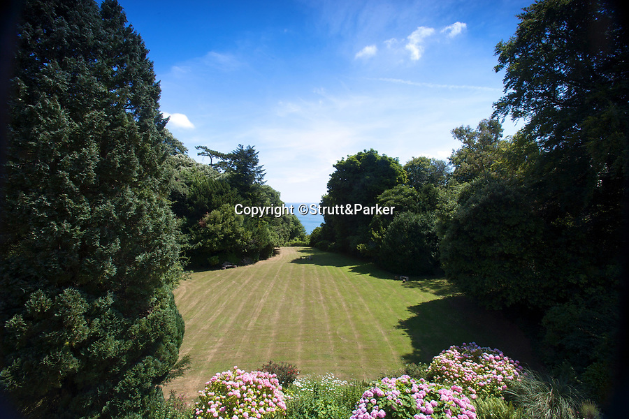 BNPS.co.uk (01202 558833)<br /> Pic: Strutt&Parker/BNPS<br /> <br /> Not so fawlty ...<br /> <br /> A stunning Victorian villa on the 'English Riviera' has emerged on the market for £1.15million.<br /> <br /> Washington House is located on the outskirts of Torquay which was the fictional setting for the classic TV comedy series Fawlty Towers.<br /> <br /> The Grade II listed five bedroom villa with 'period features' comes with 2.9 acres of land is a short walk from the scenic, secluded Watcombe Beach.<br /> <br /> John Cleese got the inspiration for his lead character Basil Fawlty after meeting an eccentric hotelier during a stay at the Gleneagles Hotel in Torquay in 1970.