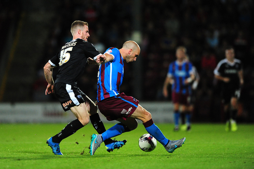 Scunthorpe United's David Mirfin vies for possession with Barnsley's Marley Watkins<br /> <br /> Photographer Chris Vaughan/CameraSport<br /> <br /> Football - Capital One Cup First Round - Scunthorpe United v Barnsley - Tuesday 11th August 2015 - Glanford Park - Scunthorpe<br />  <br /> &copy; CameraSport - 43 Linden Ave. Countesthorpe. Leicester. England. LE8 5PG - Tel: +44 (0) 116 277 4147 - admin@camerasport.com - www.camerasport.com