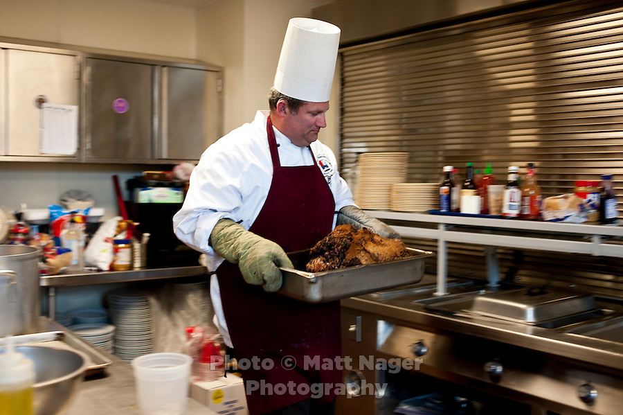Professional Chef Ken Cobb (cq) prepares a prime rib dinner at Sigma Alpha Epsilon fraternity house on the Southern Methodist University campus in Dallas, Texas, Friday, january 20, 2011. Some high-end chefs have found professional salvation from an unlikely location: Fraternity Row. Cobb employs a pair of interns from the Dallas Culinary Institute, where he once served as lead instructor, to help him cook three meals every weekday for another pair of frat houses on SMU's campus...Matt Nager for The Wall Street Journal