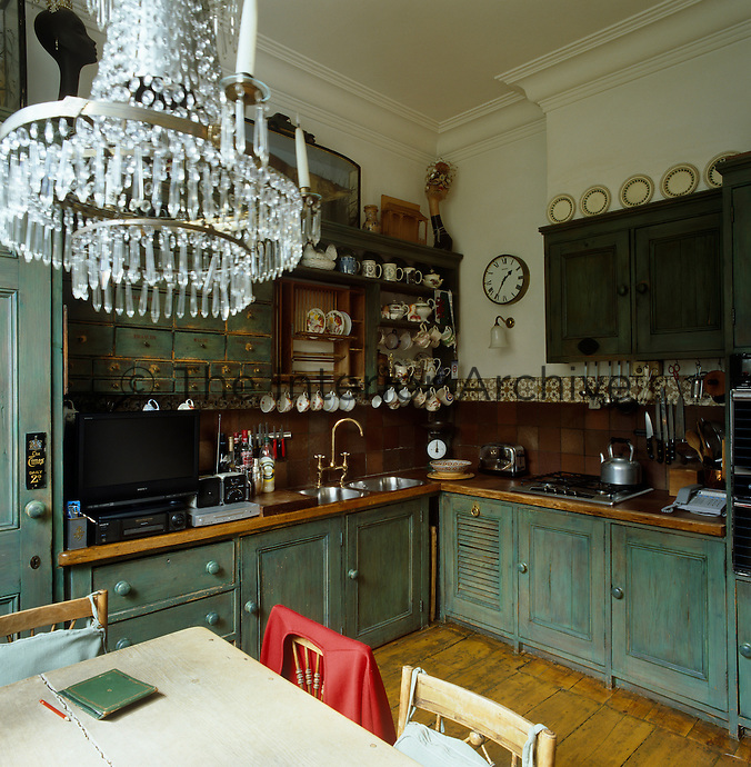 A crystal chandelier is an unexpected adornment to this country-style kitchen