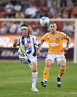 Pachuca FC midfielder Gabriel Caballero (8) receives the ball in front of Houston Dynamo defender Wade Barrett (24).  Houston Dynamo defeated Pachuca FC 2-0 in the semifinals of the Superliga 2008 tournament at Robertson Stadium in Houston, TX on July 29, 2008.