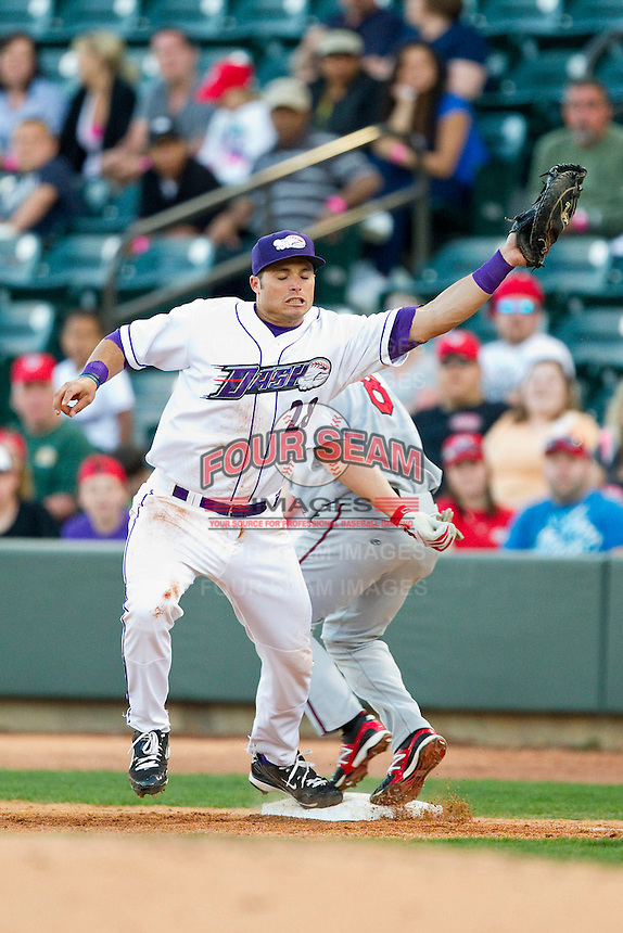 Winston-Salem Dash first baseman Grant Buckner (28) stretches for a throw as Todd Hankins (8) of the Carolina Mudcats hustles down the line at BB&T Ballpark on April 13, 2013 in Winston-Salem, North Carolina.  The Dash defeated the Mudcats 4-1.  (Brian Westerholt/Four Seam Images)