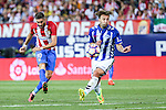 Atletico de Madrid's Yannick Ferreira Carrasco and Deportivo Alaves's Alexis Ruano during the match of La Liga Santander between Atletico de Madrid and Deportivo Alaves at Vicente Calderon Stadium. August 21, 2016. (ALTERPHOTOS/Rodrigo Jimenez)